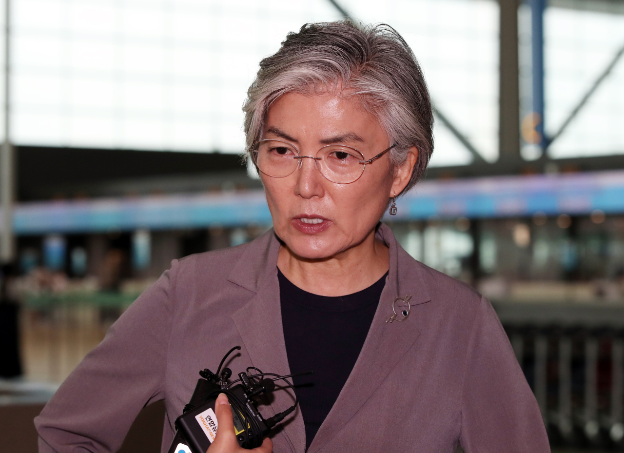 South Korean Foreign Minister Kang Kyung-wha speaks to reporters at Incheon International Airport, west of Seoul, ahead of her departure for Slovakia on June 6, 2019. (Yonhap)