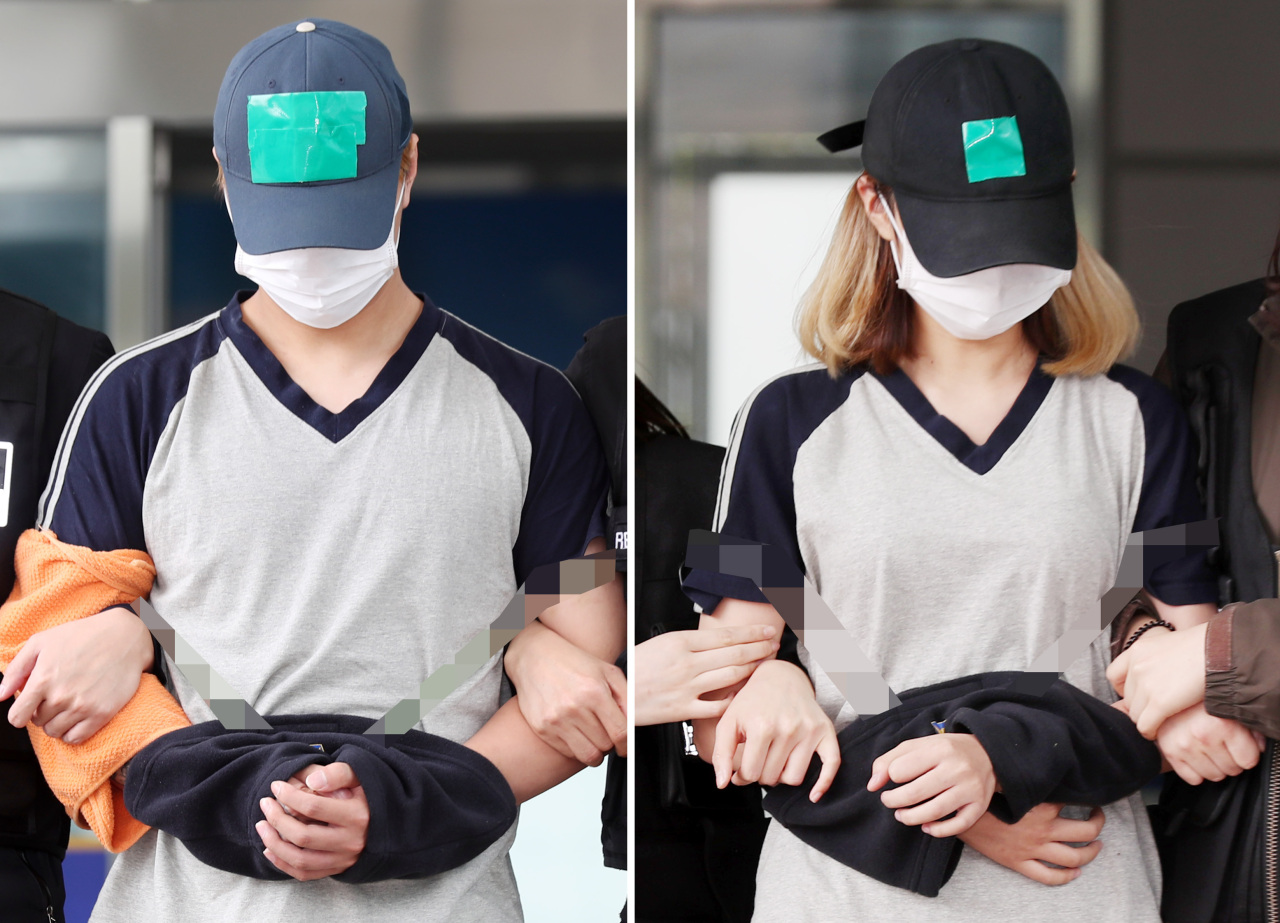 A couple accused of neglecting their 7-month-old daughter and causing her death are transported to the Incheon District Court on Friday. (Yonhap)