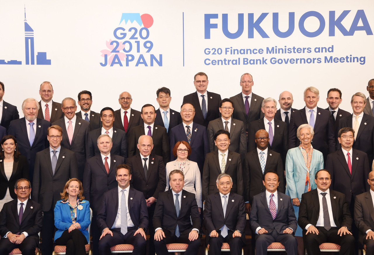 Deputy Prime Minister and Finance Minister Hong Nam-ki poses for group photograph on Sunday, the last day of the Group of 20 Finance Ministers and Central Bank Governors Meeting. (Ministry of Economy and Finance)