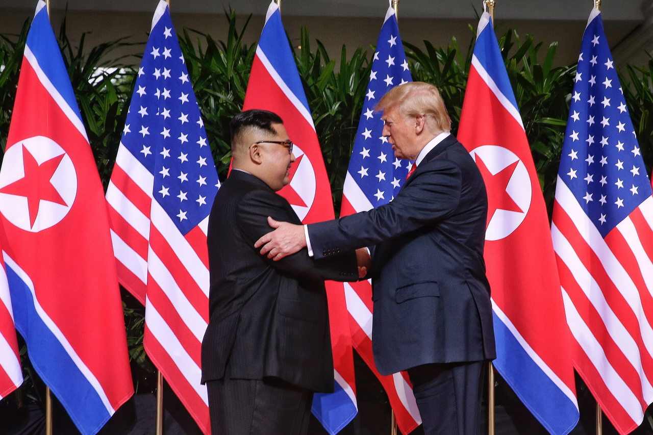 US President Donald Trump and North Korean leader Kim Jong-un at their first summit in Singapore on June 12, 2018. Yonhap