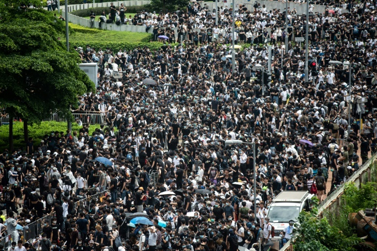 Protesters occupy the roads near Hong Kong`s Legislative Council and government headquarters, forcing lawmakers to postpone a debate on the proposed extradition law (AFP)