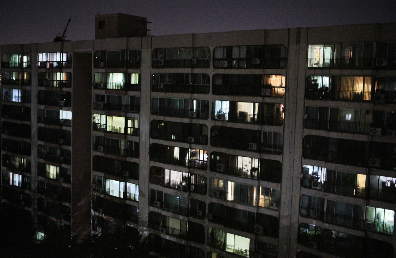 Lights stay on late into the night at an apartment complex in Gangnam, Seoul.