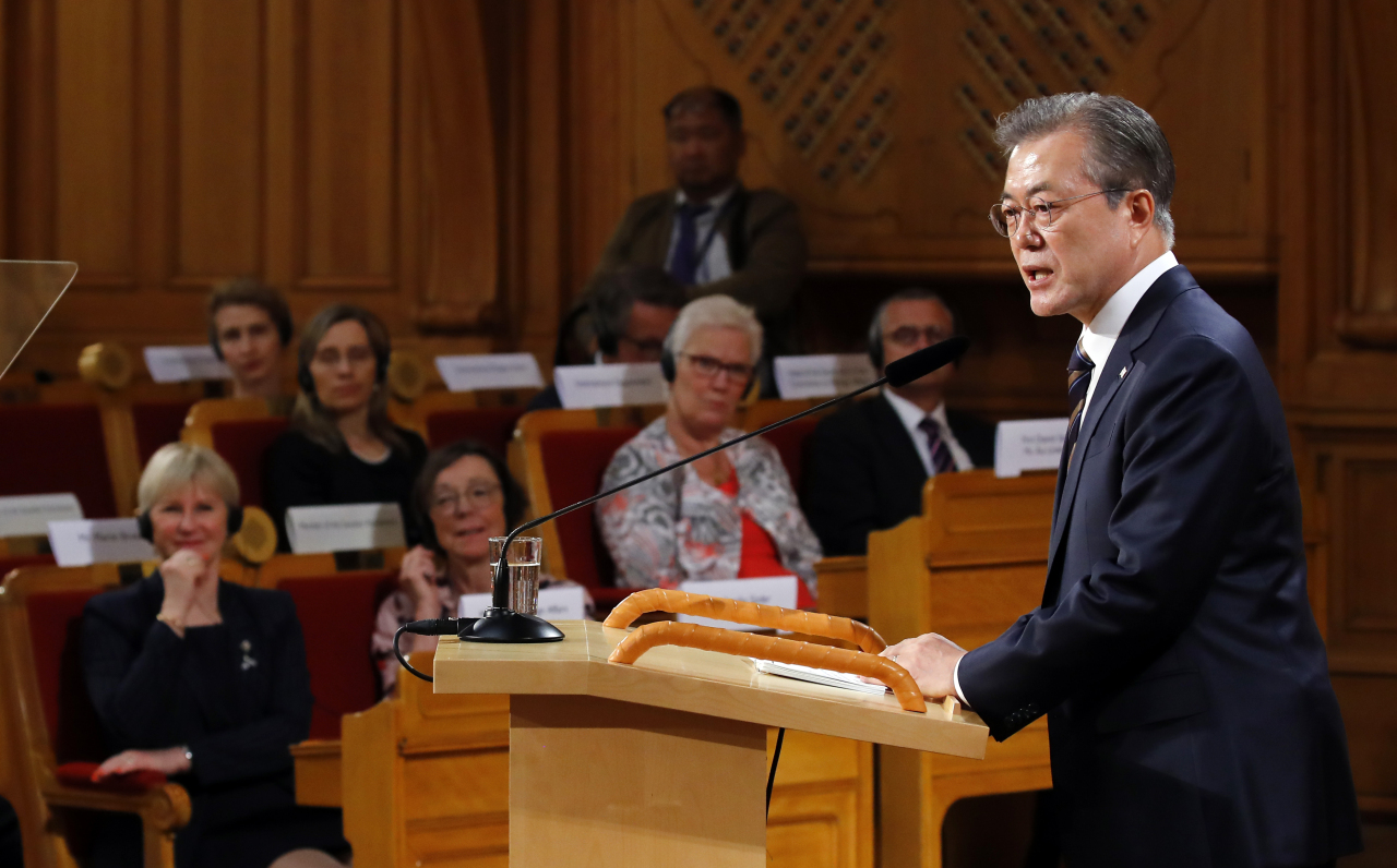 President Moon Jae-in addresses the Swedish parliament on Friday. Yonhap