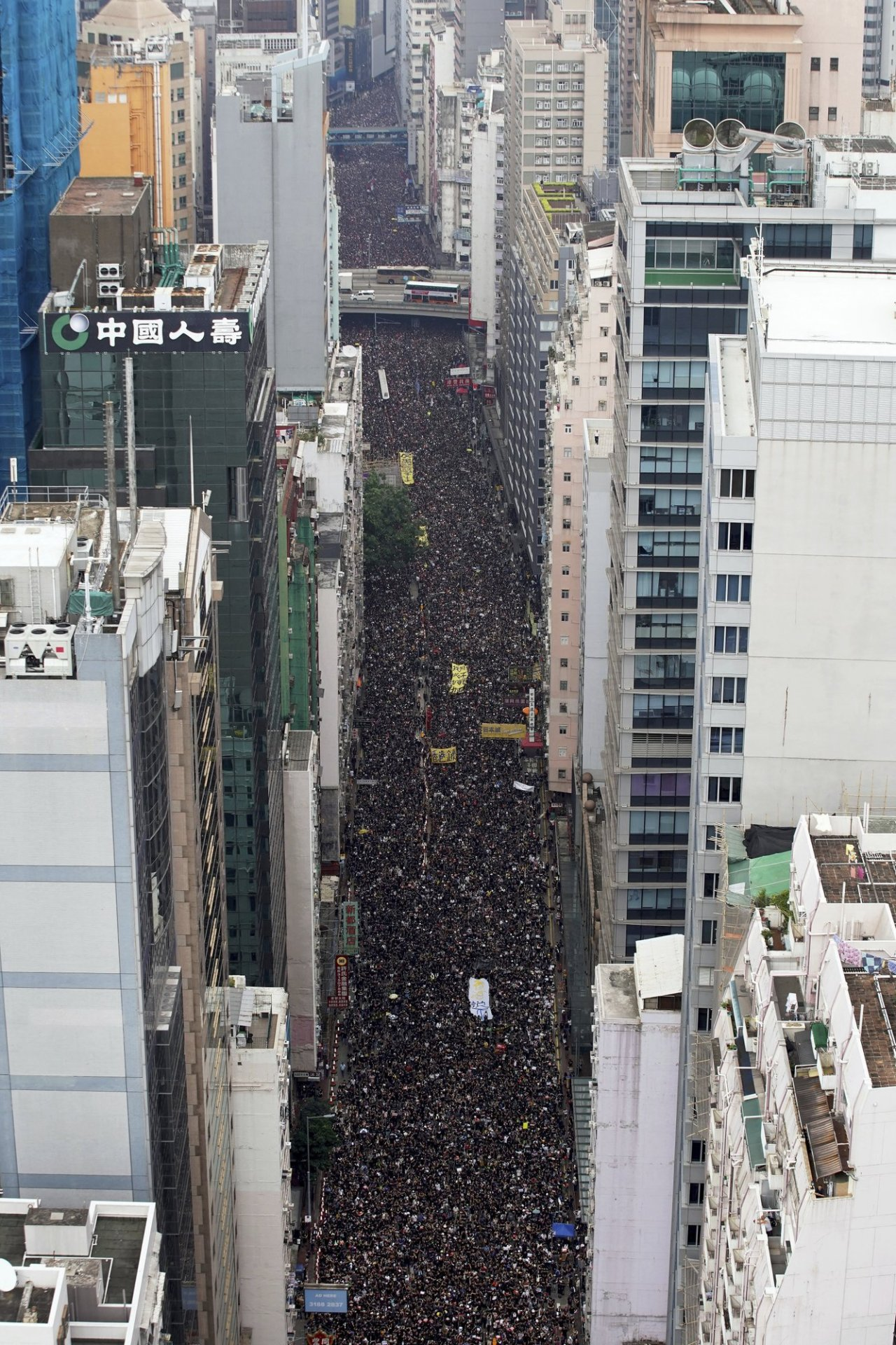 Tens of thousands of protesters carry posters and banners march through the streets as they continue to protest an extradition bill, Sunday, June 16, 2019, in Hong Kong. (AP)