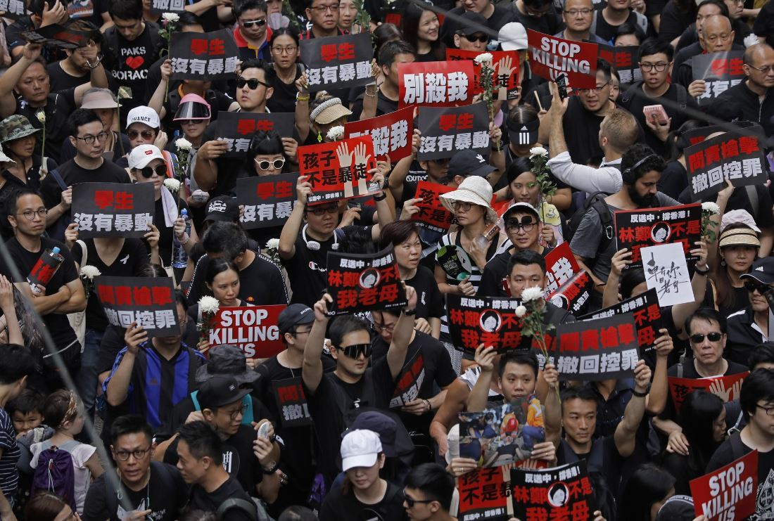 Protesters march on the streets against an extradition bill in Hong Kong on Sunday, June 16, 2019. Hong Kong residents Sunday continued their massive protest over an unpopular extradition bill that has highlighted the territory`s apprehension about relations with mainland China, a week after the crisis brought as many as 1 million into the streets. (AP)