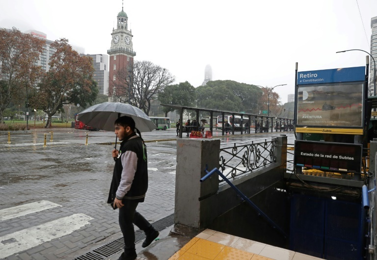 A man walks next to a closed subway station in downtown Buenos Aires during a power outage. (AFP)