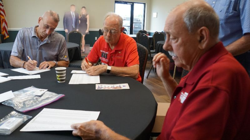 Retirees Ronald McMahan (R), Don Eaton (C) and Andy Bilardello, all leaders of local Republican clubs, address envelopes inviting new residents to join the clubs in The Villages, Florida; all are supporters of US President Donald Trump. (AFP)