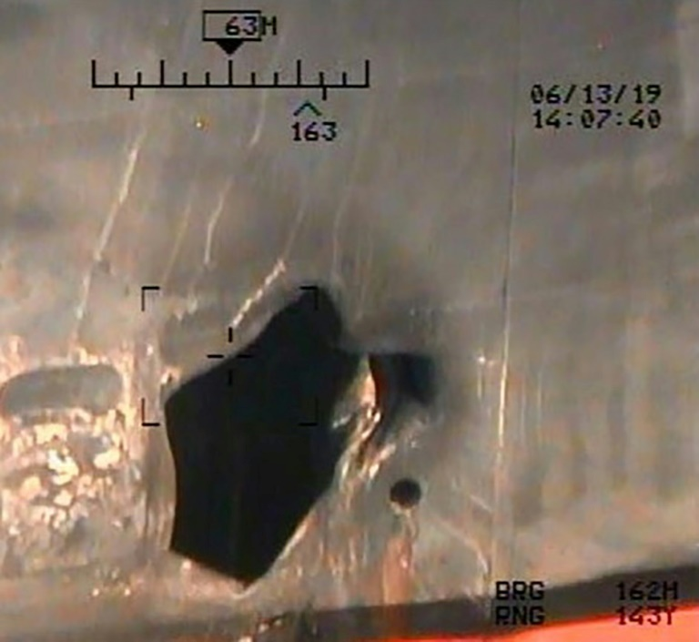 An image released by the US Department of Defense on July 17, 2019 shows damage from an alleged limpet mine attack on a tanker in the Gulf of Oman (AFP-Yonhap)
