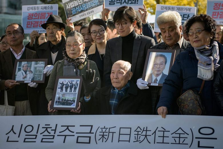 Mr Lee Choon-shik (center), a victim of forced labour by Japan during its colonial rule of the Korean peninsula from 1910 to 1945, is surrounded by supporters and relatives outside the supreme court in Seoul, on Oct 30, 2018. (AFP-Yonhap)
