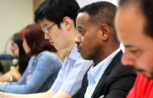 Asylum-seekers and refugees speak at a press conference in Seoul, Tuesday. (Yonhap)
