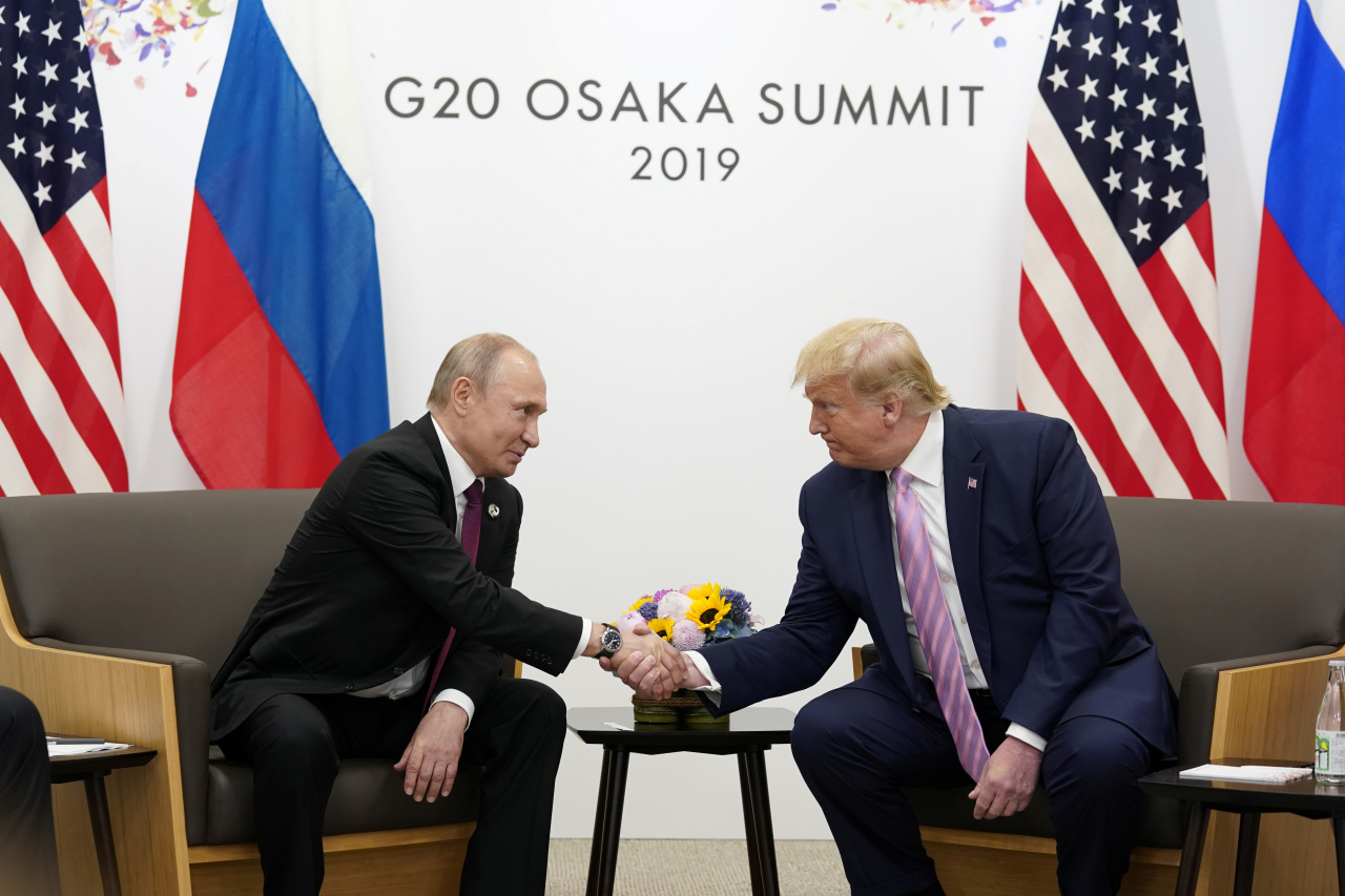Russia's President Vladimir Putin (left)and US President Donald Trump shake hands during a bilateral meeting at the G20 leaders summit in Osaka, Japan, June 28, 2019. (REUTERS/Kevin Lamarque)