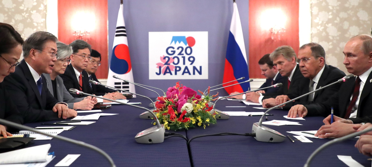 President Moon Jae-in and Russian President Vladimir Putin hold a summit meeting in Osaka, Japan on Saturday. Yonhap