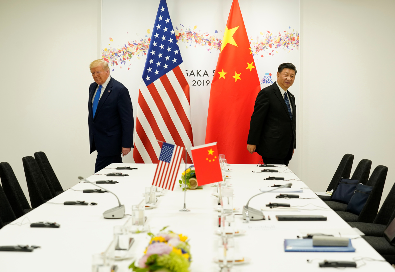 US President Donald Trump and Chinese President Ji Jinping attend their bilateral meeting on Sunday during the G20 summit in Osaka, Japan. (Yonhap)