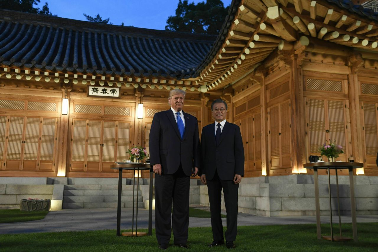 US President Donald Trump (left) stands with President Moon Jae-in (right) during a visit to the tea house at the Blue House in Seoul. Trump is visiting Seoul after attending the G-20 summit in Osaka, Japan. (AP)