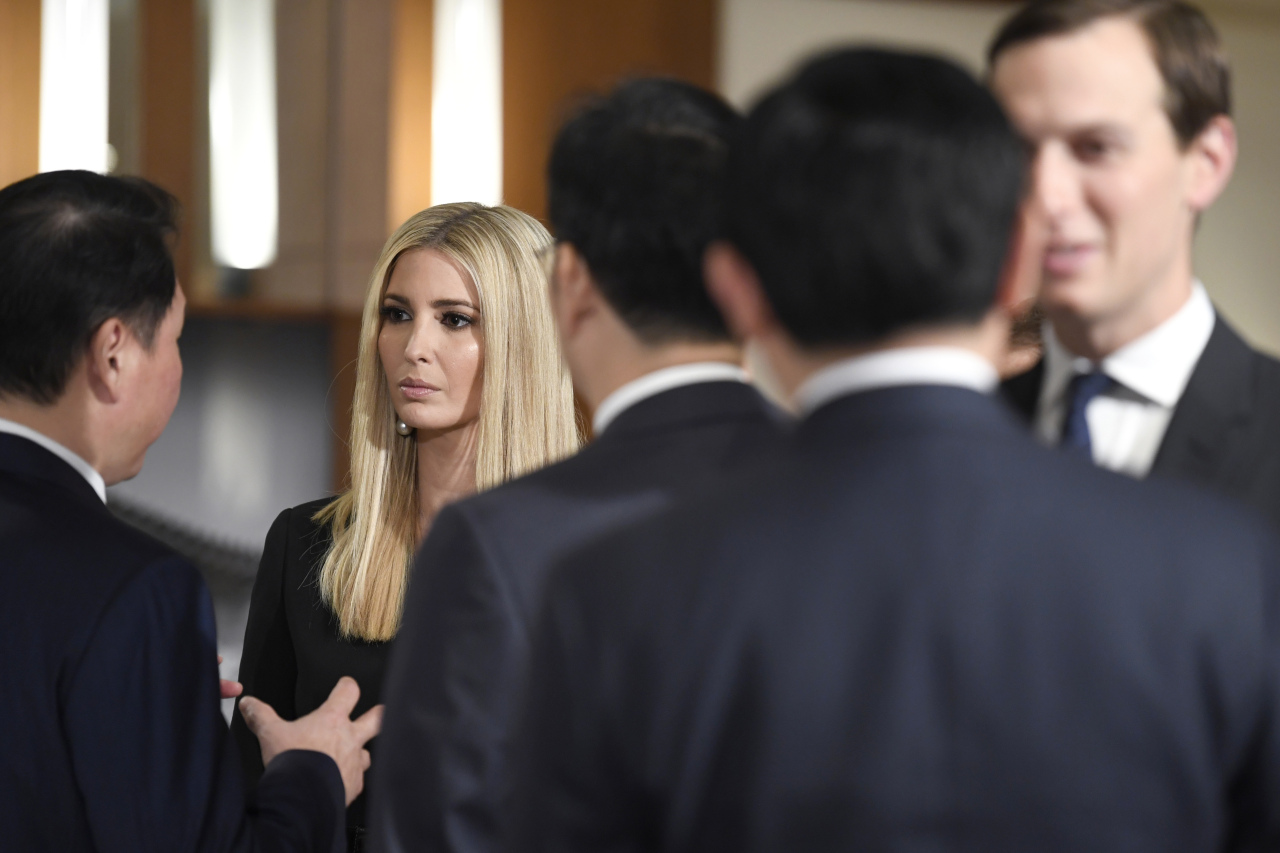 Ivanka Trump (second from left) and White House adviser Jared Kushner (right) talk with people before President Donald Trump addresses Korean business leaders. (AP)