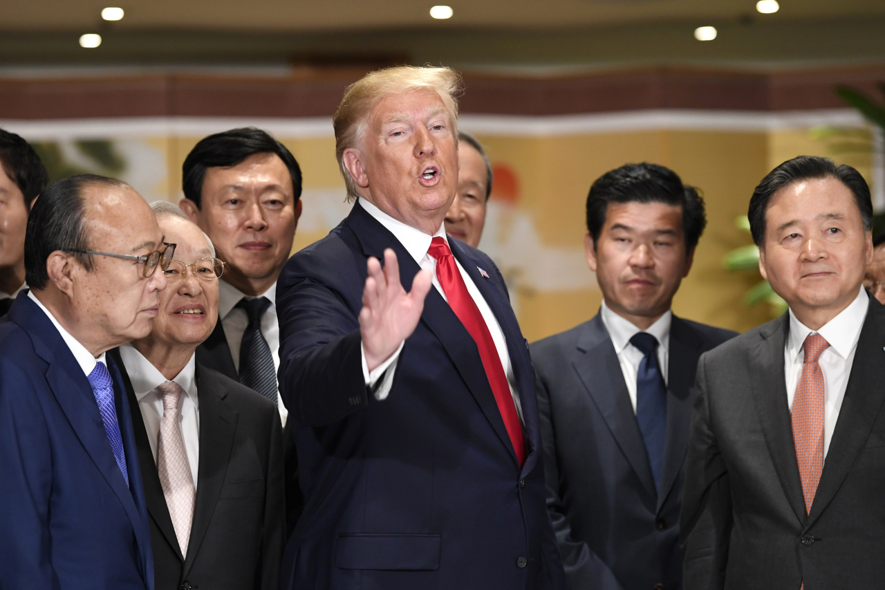 US President Donald Trump attends an event with business leaders at the Hyatt Hotel. (Reuters)