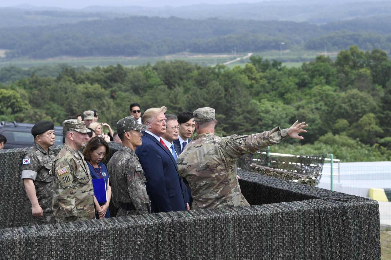 Presidents Moon and Trump visit DMZ observation post together. (Yonhap)