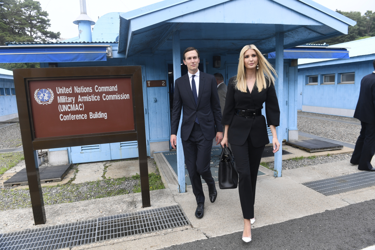 White House Senior Advisors Ivanka Trump and Jared Kushner, walk in the border village of Panmunjom in the Demilitarized Zone, South Korea, Sunday. (AP-Yonhap)
