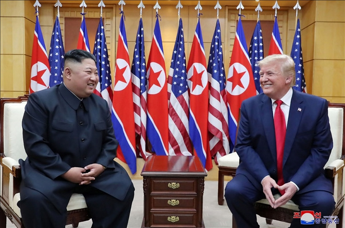 US President Donald Trump and North Korean leader Kim Jong-un hold a meeting at the South Korean side of Panmunjom on Sunday. Yonhap