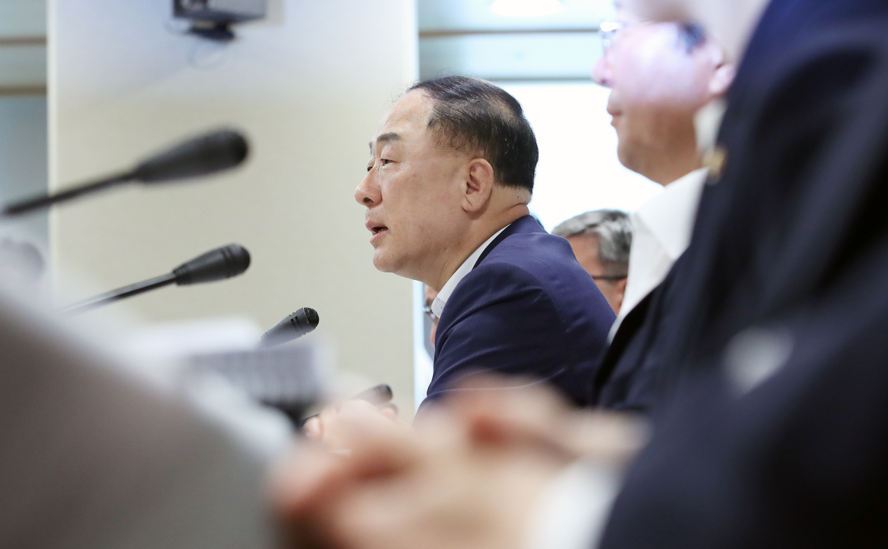 Deputy Prime Minister and Finance Minister Hong Nam-ki speaks in a press briefing, announcing the government's revised outlook on the nation's economy for the second half of the year. (Yonhap)