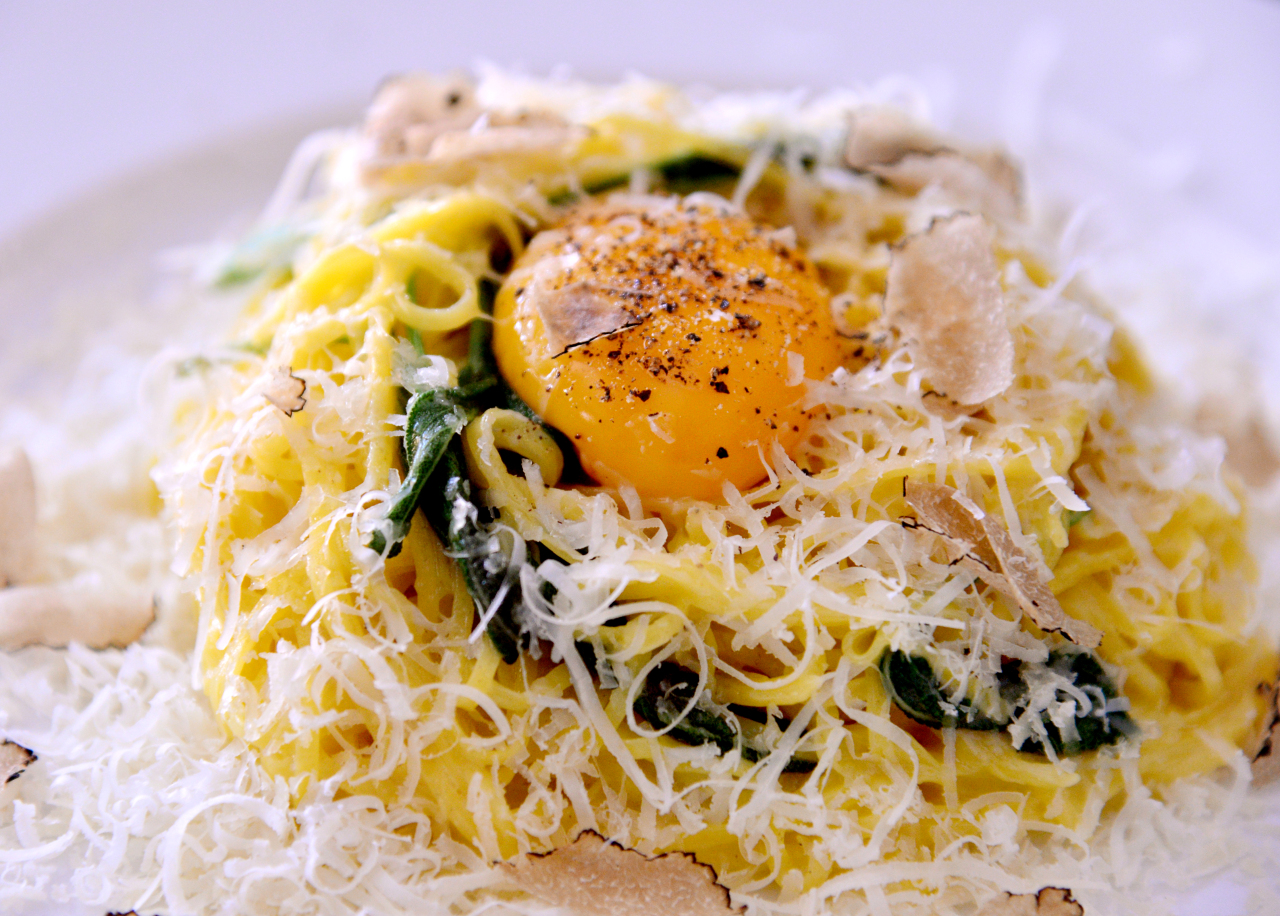 It'el JAE serves housemade tajarin in sage-infused butter, strewn with slices of black truffle and showered with pungent Pecorino and Grana Padano cheeses. A barely poached yolk is nestled in the center (Park Hyun-koo/The Korea Herald)
