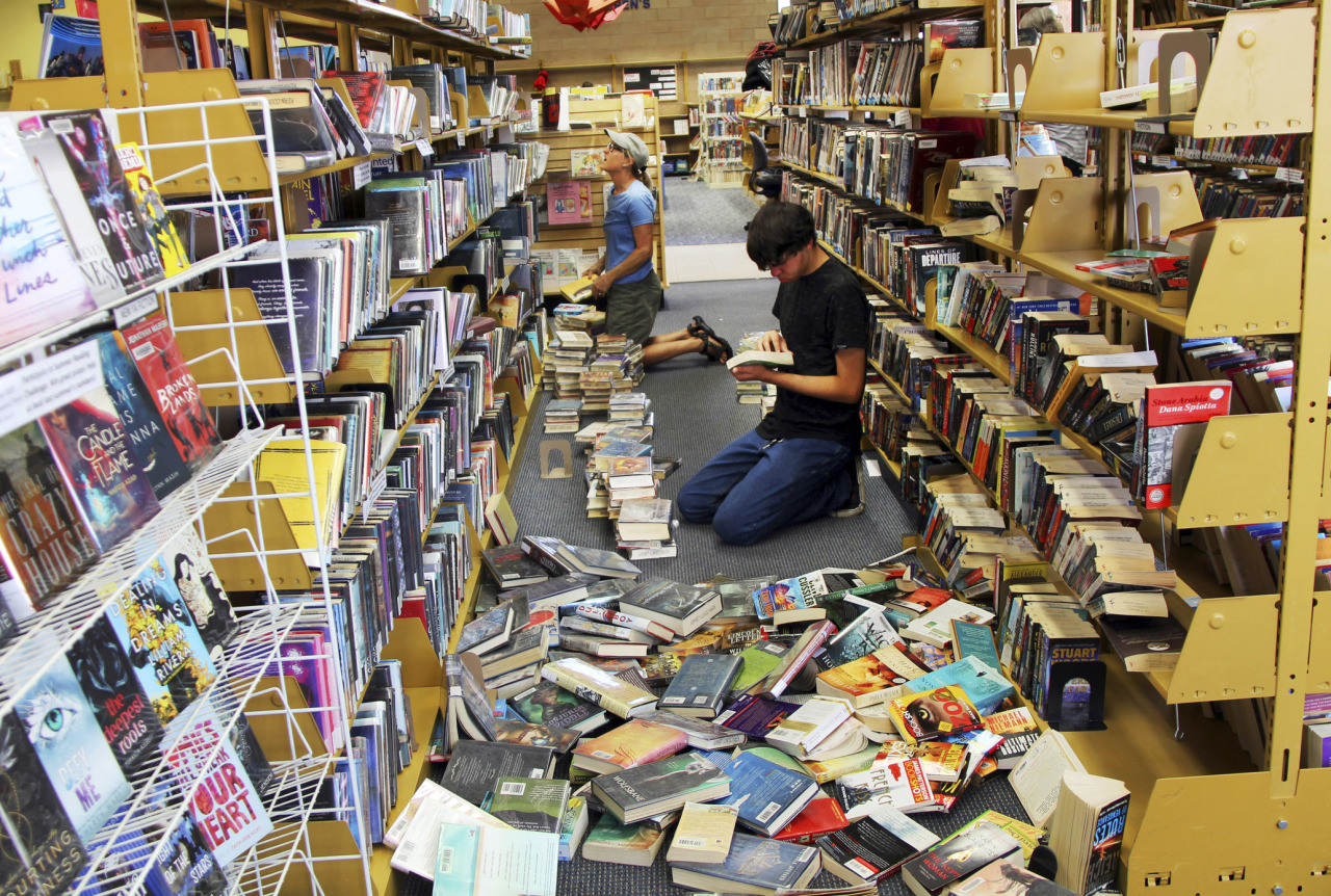 Volunteers assist with cleanup at the Ridgecrest, Calif., branch of the Kern County Library on Friday, July 5, 2019, following a 6.4 magnitude earthquake that shook the region about 240 kilometers northeast of Los Angeles Thursday. (AP)