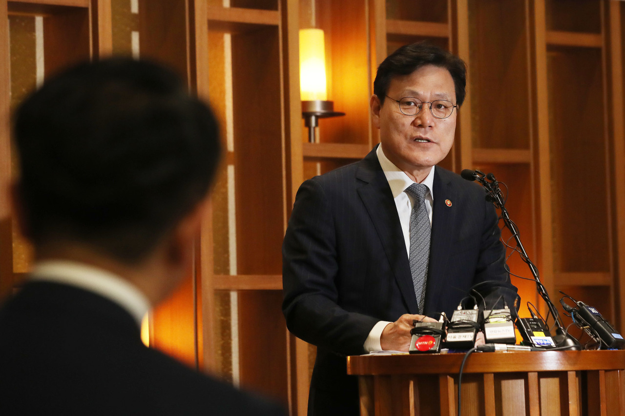 Financial Services Commission Chairman Choi Jong-ku speaks Friday in a press conference. (Yonhap)