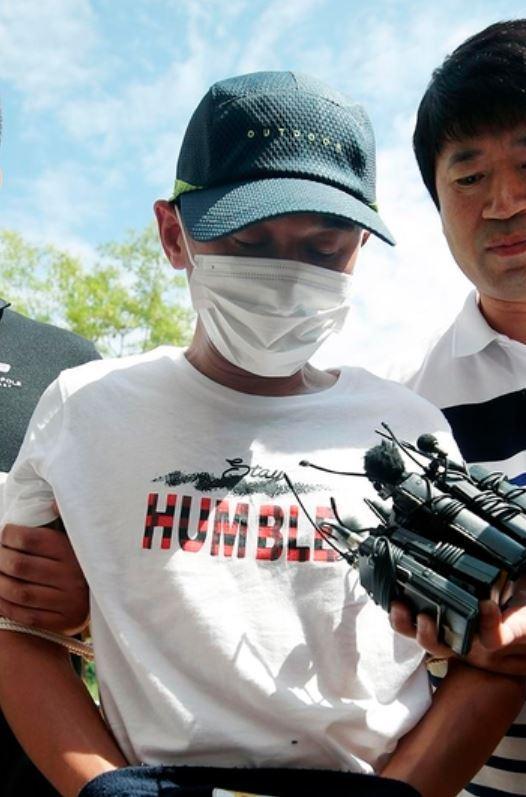Police escort Kim to Gwangju District Court on Monday. (Yonhap)