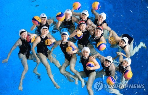 In this file photo from June 27, 2019, members of the South Korean women`s water polo team pose for photos before their practice in Suwon, 45 kilometers south of Seoul, in preparation for the FINA World Championships. (Yonhap)