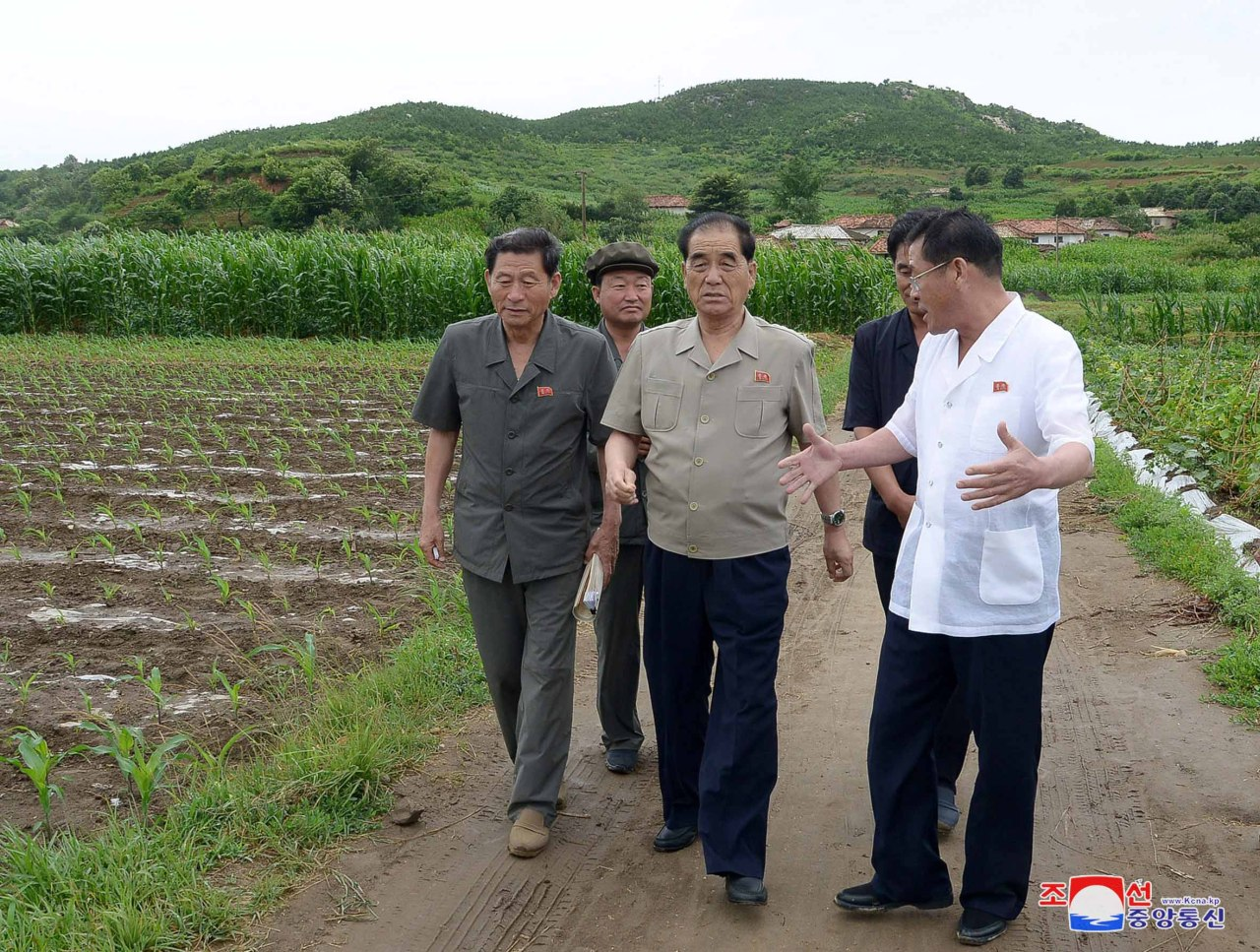 Pak Pong-ju, vice chairman of North Korea's State Affairs Commission, inspects a site for farmland and tideland reclamation in southwestern North Korea in this photo provided by the Korean Central News Agency on July 16, 2019. (Yonhap)