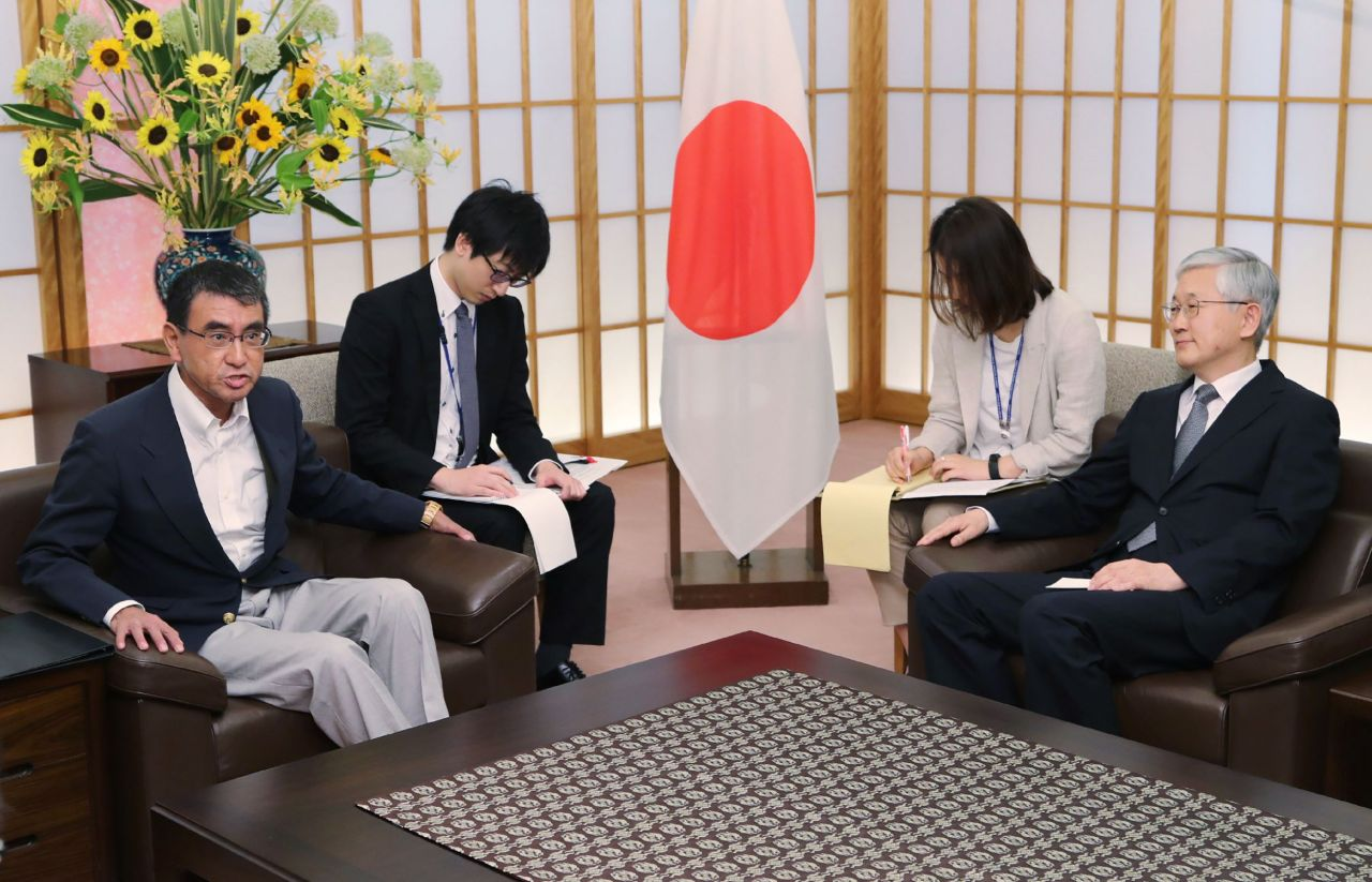 Japan's Foreign Minister Taro Kono (left) holds a meeting with South Korea's Amba ssador to Japan Nam Gwan-Pyo at his office in foreign ministry in Tokyo on Friday. (Yonhap)