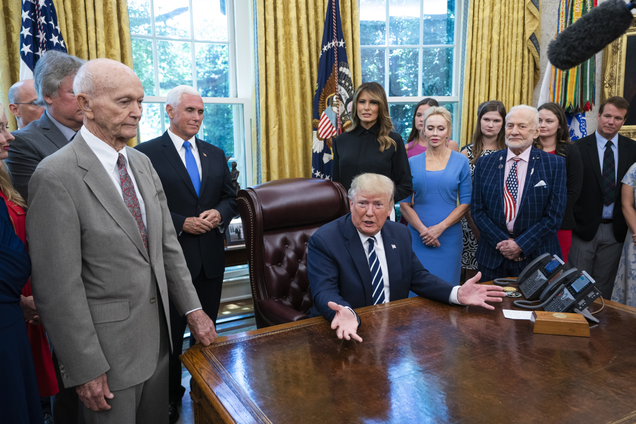 US President Donald J. Trump welcomes astronauts Buzz Aldrin(R), Michael Collins (L), and the family of Neil Armstrong to the Oval Office honor the 50th anniversary of the Apollo moon landing in the Oval Office of the White House in Washington on Friday. (EPA-Yonhap)