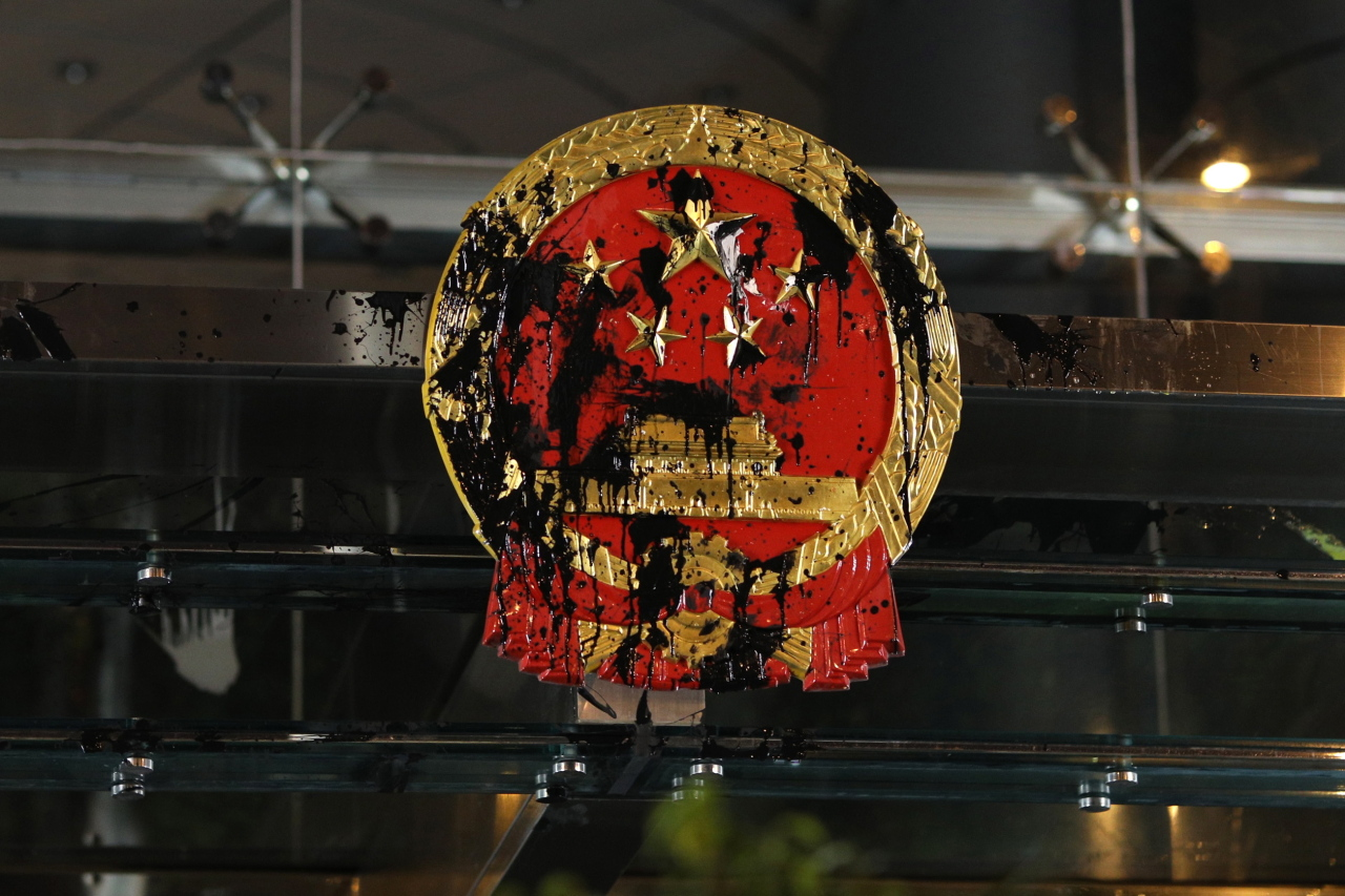 The Chinese national emblem at the China Liaison Office is splashed with paint by anti-extradition bill protesters during a rally in Hong Kong. (EPA=Yonhap)
