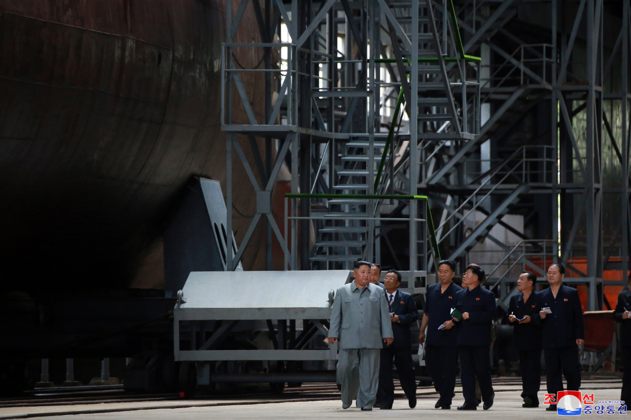 North Korean leader Kim Jong-un inspects a new submarine (Yonhap)