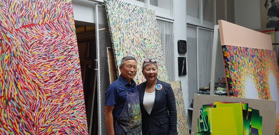 Artist Woo Jae-ghil (left) and WooJaeghil Art Museum's director Kim Cha-soon pose at Woo's basement workshop at the museum. (Shim Woo-hyun/The Korea Herald)