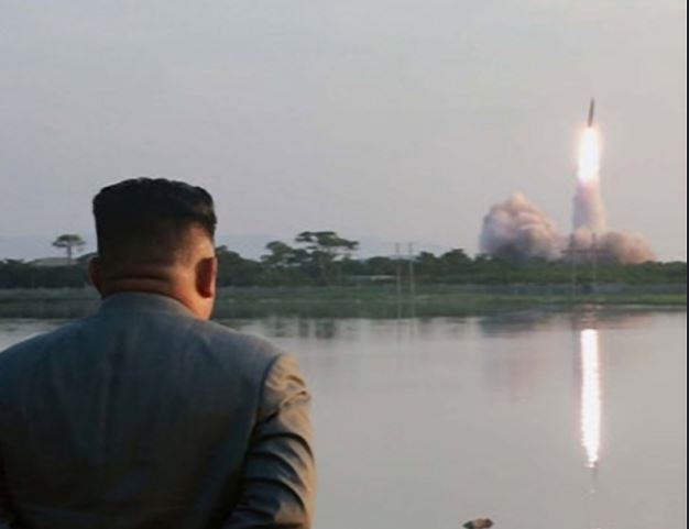 North Korean leader Kim Jong-un watches a missile launch from a site near the North's eastern coastal town of Wonsan on Thursday. (Yonhap)