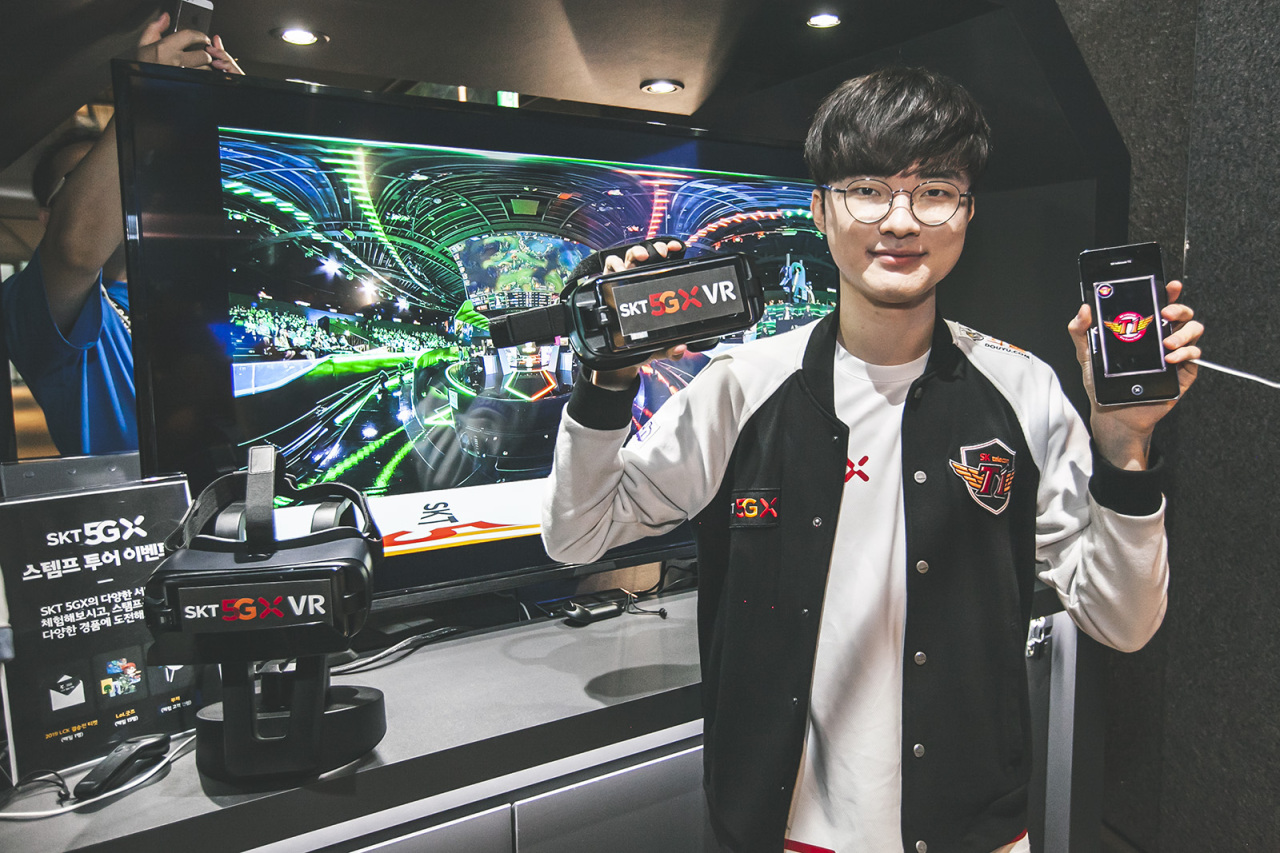 SKT T1 pro League of Legends player Faker holds goggles for the LCK VR livestream and Jump AR. (SKT)