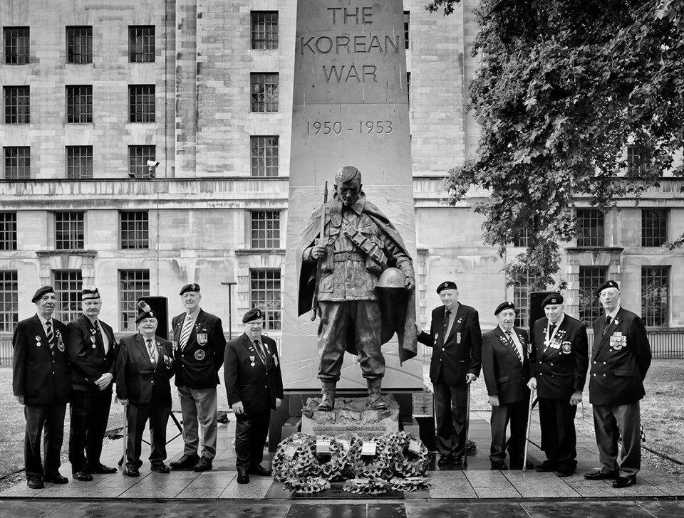 Korean War veterans pose in front of the Korean War Memorial in London on Saturday. (Rami Hyun)