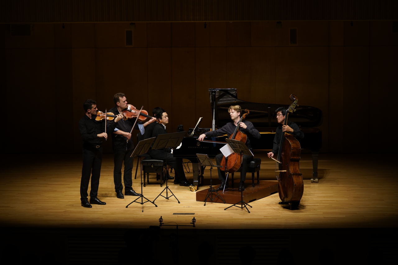 "From left: Violinist Svetlin Roussev, violist Gareth Lubbe, pianist Kim Sun-wook, cellist Julian Steckel and double bassist Michinori Bunya play Franz Schubert's Piano Quintet in A major, ""Trout,"" as part of the concert ""Once Upon a Time,"" Wednesday in PyeongChang, Gangwon Province. (Music in PyeongChang)"
