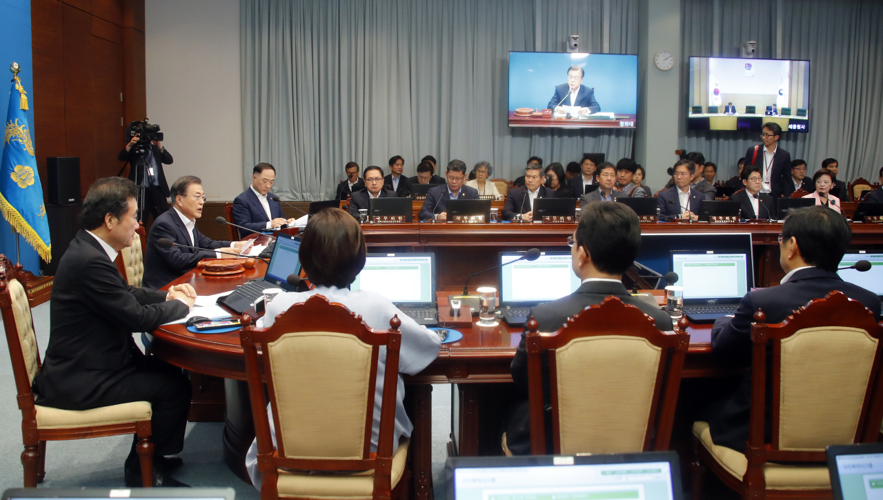 President Moon Jae-in presides over a Cabinet meeting on Friday. Yonhap