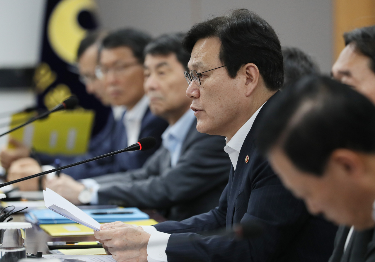 FSC Chairman Choi Jong-ku speaks at a meeting held at the government complex in Seoul on Saturday. (Yonhap)