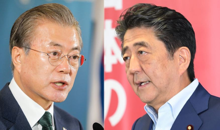 Korean President Moon Jae-in (left) and Japanese Prime Minister Shinzo Abe (AP)