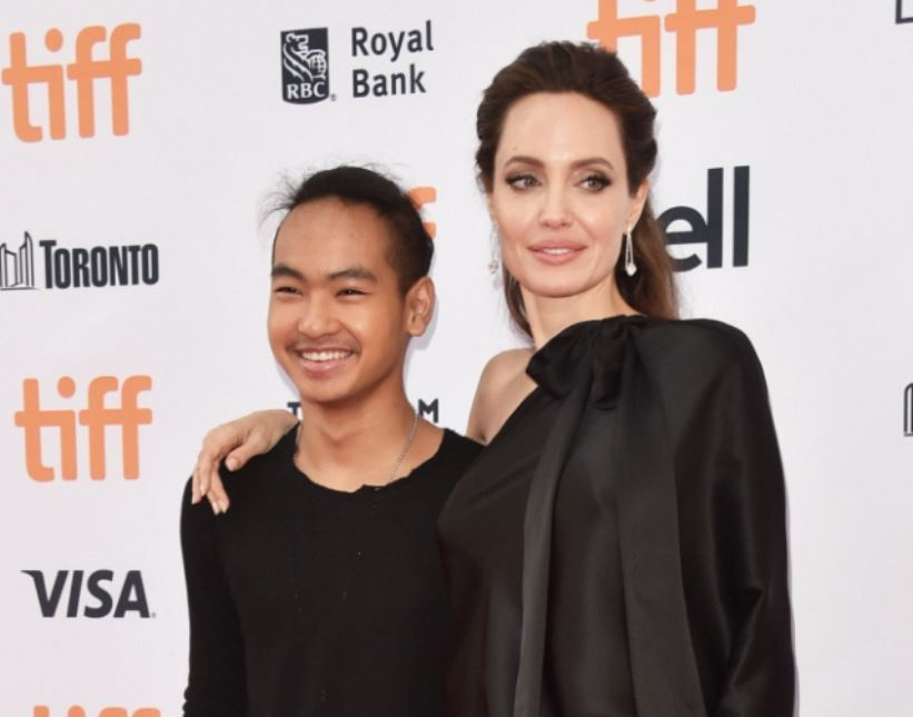 Angelina Jolie, right, and her son Maddox (AFP)