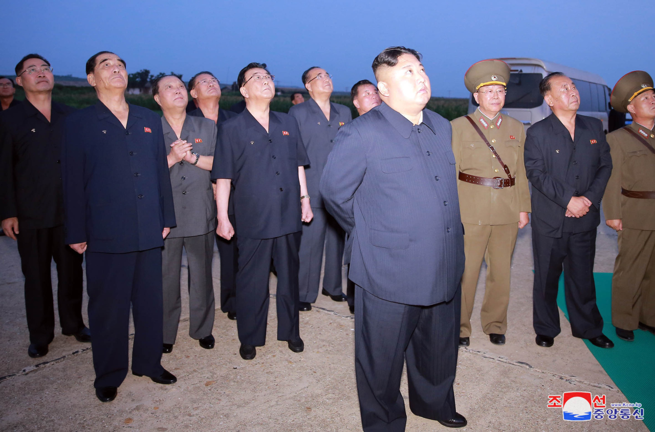 North Korean leader Kim Jong-un watches the launch of a newly developed guided weapon on Tuesday. Yonhap