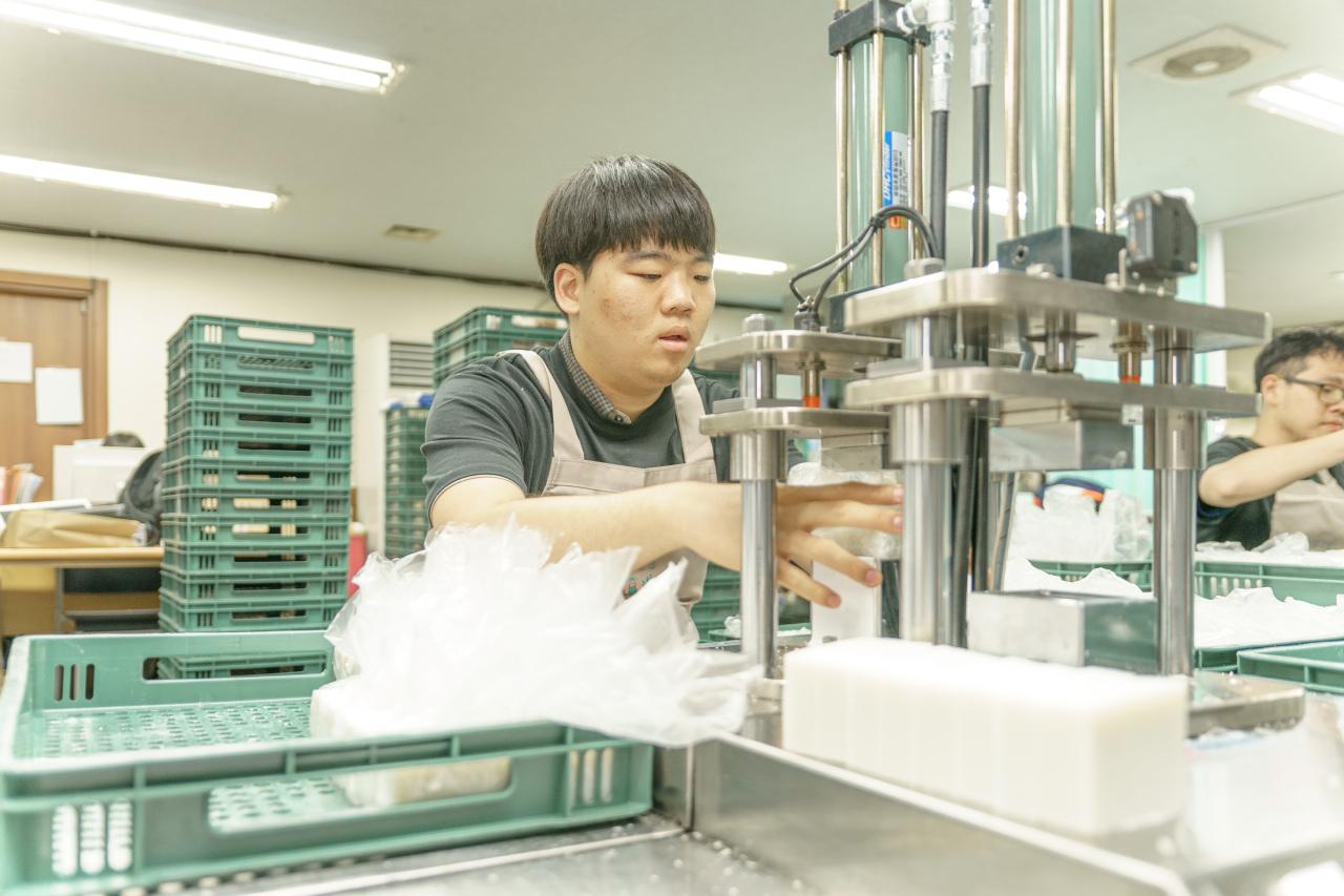 A worker at Donggubat makes premium organic soaps at the company's factory in Seongdong-gu, Seoul. (Donggubat)