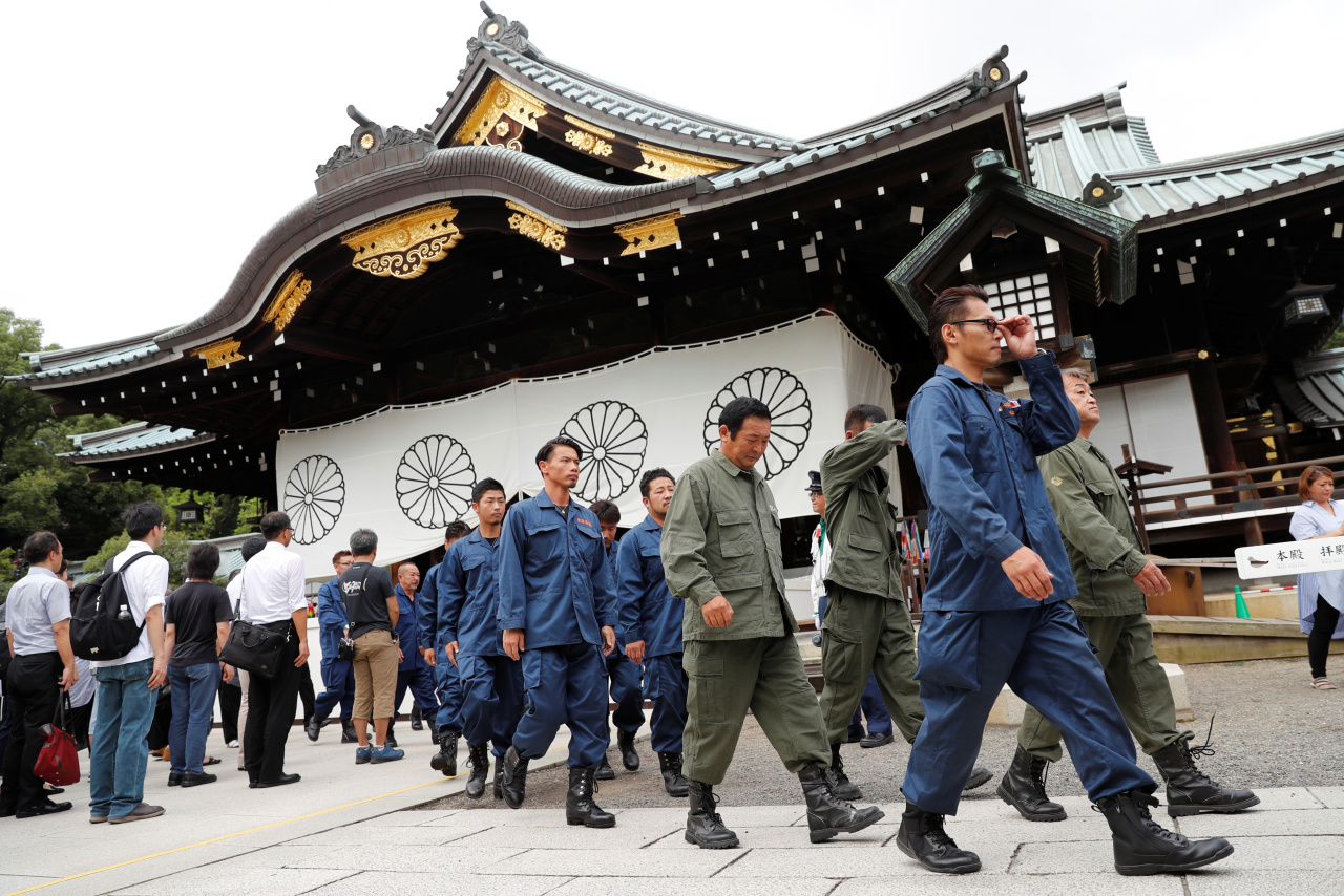 Right wing group members in uniform leave after paying tribute to the war dead at Yasukuni Shrine in Tokyo, Japan August 15, 2019, on the 74th anniversary of Japan`s surrender in World War Two. (Reuters)