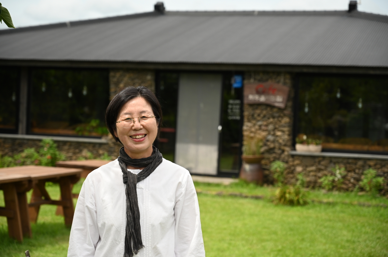 Kim Hee-sook poses for a photograph at her family-run Jeju Island Brewery in Seungeup Folk Village on Jeju Island on Aug. 9. (The Korea Herald)