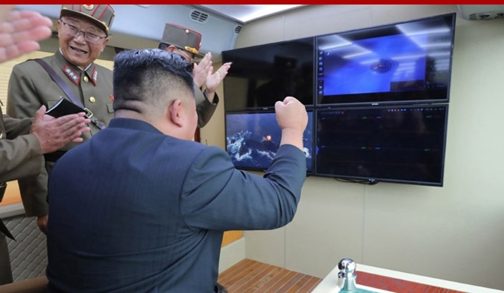This photo, released by North Korea`s Central News Agency on Aug. 17, 2019, shows North Korean leader Kim Jong-un (C) reacting to the country`s test of a