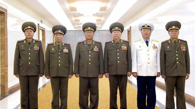 A North Korean military delegation, led by Kim Su-gil (3rd from L), the director of the General Political Bureau of the North's Korean People's Army, poses in this photo released on Aug. 17, 2019, by the North's Korean Central News Agency. (Yonhap)