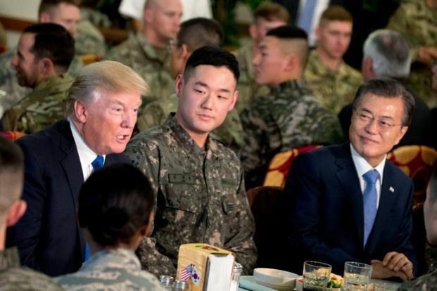 South Korean President Moon Jae-in and US President Donald Trump have lunch with US and South Korean tropps at Camp Humphreys in Pyeongtaek, South Korea. (AP)